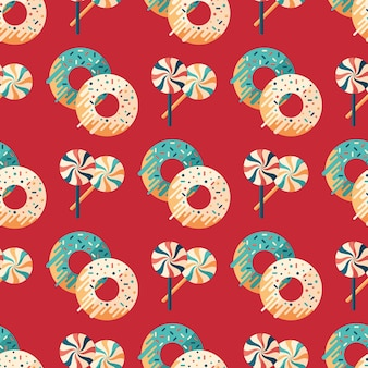 クリスマスキャンディーとドーナツフラットアートシームレスパターン。