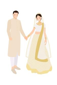 美しいインドのカップルの伝統的な結婚式のサリーで新郎新婦ドレスフレイスタイル