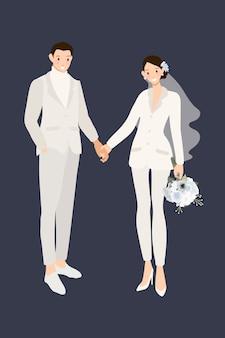 手を繋いでいる白いスーツのズボンで流行に敏感な結婚式のカップル