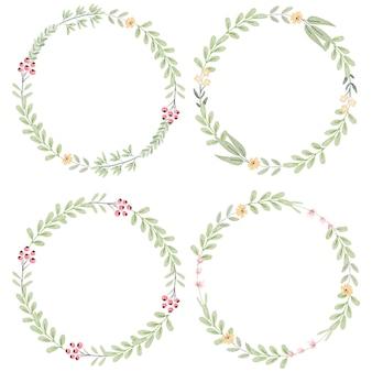 水彩画の植物の手描きの小さなピンクと黄色の花のコレクションと花輪を葉します。