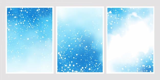 雪が降る背景の青い水彩画