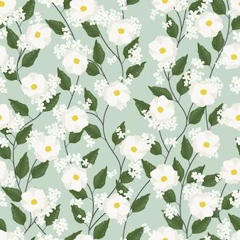 緑に白いコスモスの花のシームレスパターン