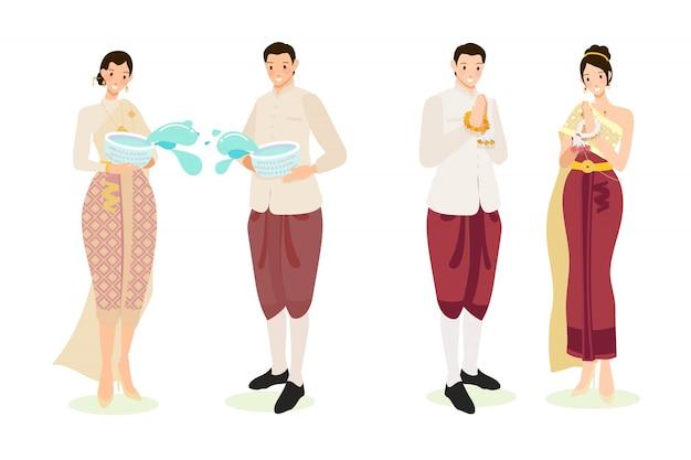 ソンクラン新年祭りの伝統的な衣装でかわいいタイのカップル