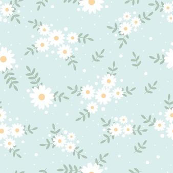 青色の背景のシームレスなパターンのかわいいフラットスタイルの小さな白いデイジーの花