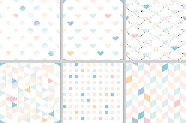 虹パステル調の心と幾何学的なシームレスパターンコレクション