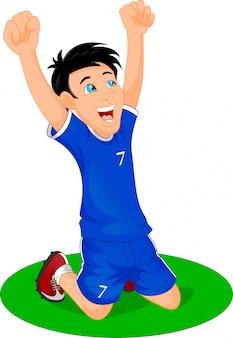 サッカー選手は目標を祝う