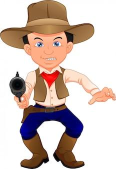 銃を持つかわいいカウボーイ子供