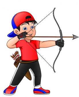 Ребенка занимаются спортивной стрельбой из лука
