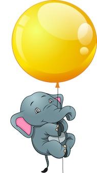 Милый слон висит на воздушном шаре