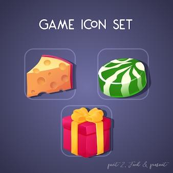 漫画のスタイルのゲームのアイコンのセットです。食べ物とプレゼント:チーズ、キャンディー、箱。アプリのユーザーインターフェースのための明るいデザイン