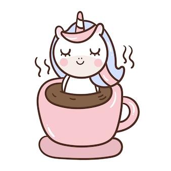 かわいいユニコーン漫画はコーヒーカップでリラックスします。