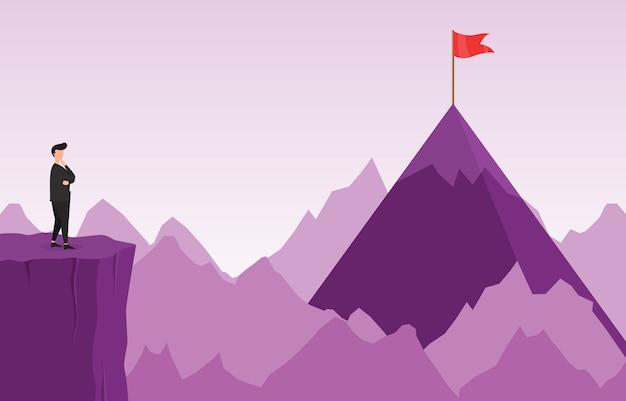障害物ビジネスコンセプトでターゲットに到達する方法を考えて崖の上のビジネスマン