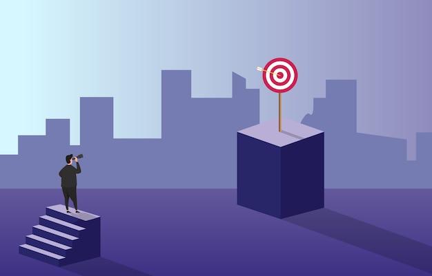 成功のビジネスコンセプトのためのターゲットビジョンを見て階段の上のビジネスマン