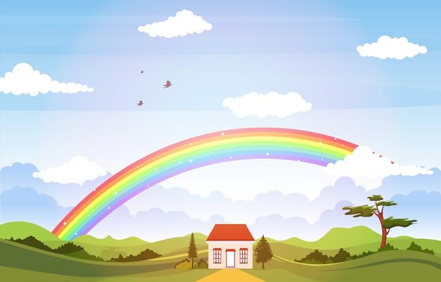 緑の牧草地の山の自然と美しい虹の空