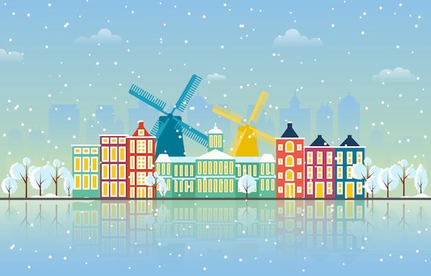 アムステルダム市の都市景観のスカイラインのランドマークの建物図の冬の雪