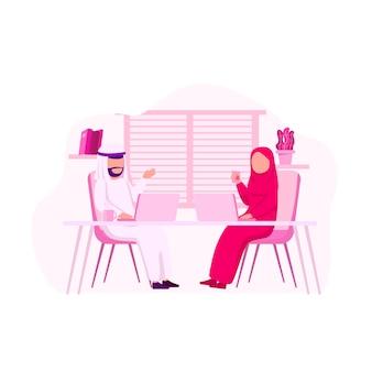 アラビア語の担当者が共同作業の図について説明します