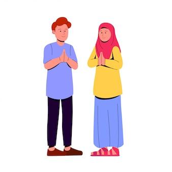 ジェスチャーを祈って二人の若いイスラム教徒のカップル