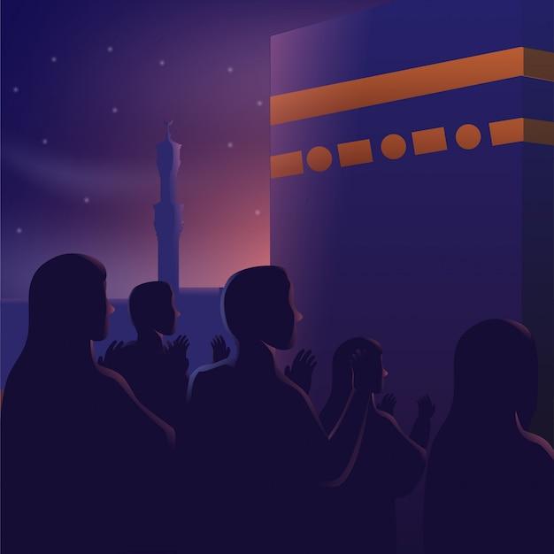 カーバ神殿の美しい夜空の前で祈る人々