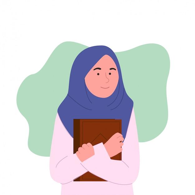 本とかわいい若いヒジャーブ女性