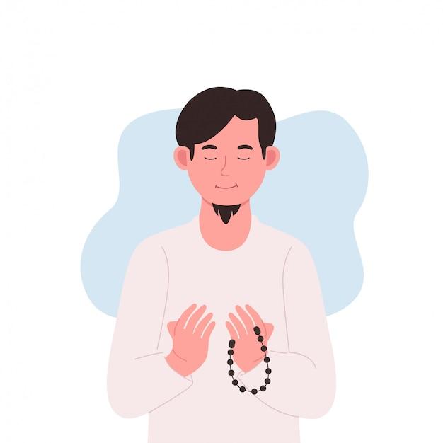 Молодой мусульманин молится с четками