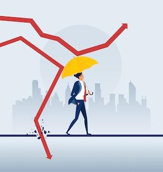 Бизнесмен держа зонтик защищает график вниз