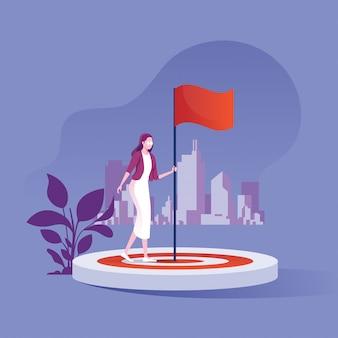 達成の比喩としてターゲットに立っている旗を持ったビジネスマン