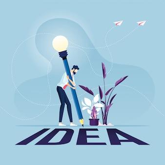 Бизнесмен с карандашом, написание идеи на полу креативная идея концепции