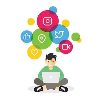 インターネットのソーシャルメディアを閲覧するラップトップで座っている少年
