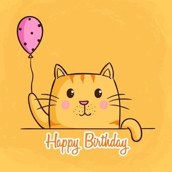 Празднование дня рождения с милой оранжевой кошкой на оранжевом фоне