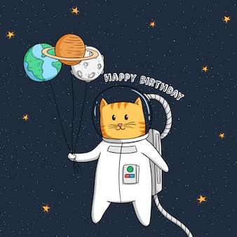 誕生日のお祝いのための惑星気球を持つ宇宙飛行士猫