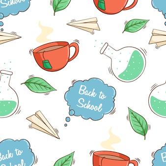 色付きの落書きスタイルでシームレスなパターンでかわいいアイコンを学校に戻る