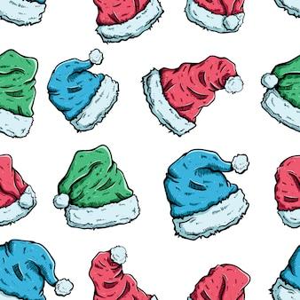 手でシームレスパターンでカラフルなクリスマス帽子白い背景の上の描画スタイル