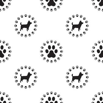 犬の足のシームレスなパターンベクトルは、子犬の壁紙を隔離