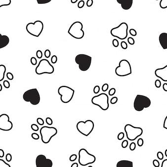犬の足のシームレスなパターンの心臓のフットプリント
