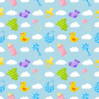 赤ちゃんのおもちゃと服アイコンのシームレスなパターン。青の新生児アイテム。