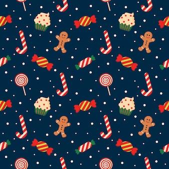 Бесшовный узор с милой мультяшной рождественской конфетой на синем фоне