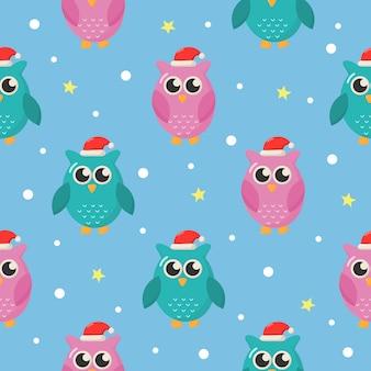 クリスマス青の背景にフクロウとのシームレスなパターン。
