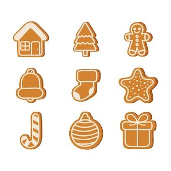 ジンジャーブレッドクッキーは、白で隔離されるクリスマスを設定します。