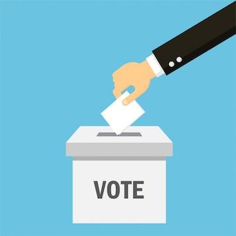 実業家の手が分離ボックスに投票用紙を置く