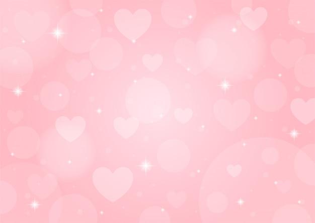 背景のボケ味を持つピンクのぼやけたバレンタインの日