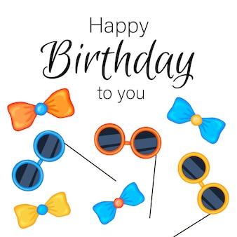 お祝いアイテムと白い背景の上の碑文「お誕生日おめでとう」。お祝いイベント。色とりどり。 。