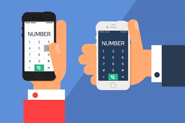 スマートフォンのダイヤルと社会生活。手で電話をかけ、フラットミニマルスタイルの番号を持つスマートフォンの画面。