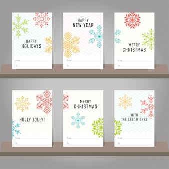 Коллекция рождественских и новогодних подарочных карт, тегов. карточки с символами снежинок.