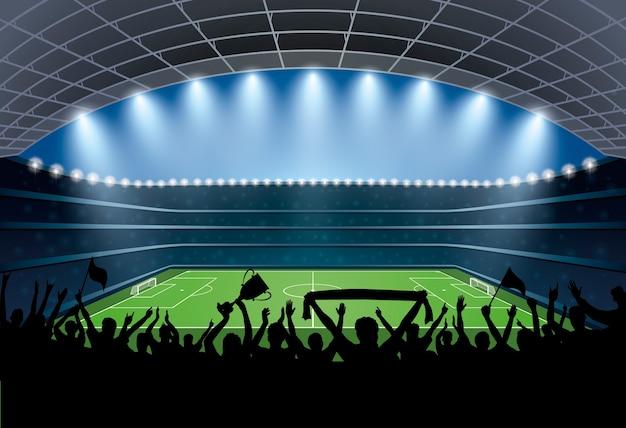 サッカースタジアムで人々の興奮した群衆