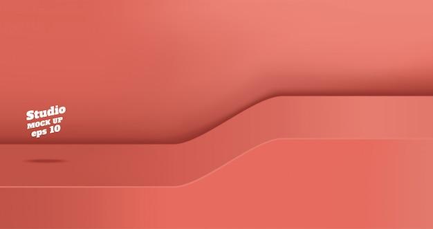 Пустой яркий кораллово-розовый студийный стол