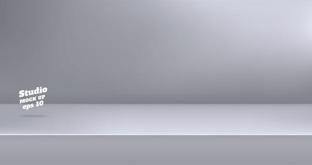 空のモダンなグレー色のスタジオテーブルルームの背景