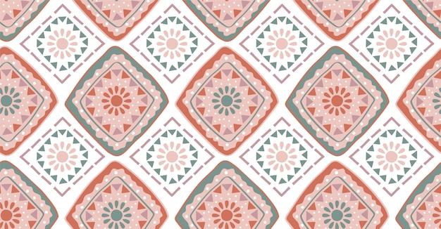アフリカ風のピンクグリーンの幾何学的なシームレスパターン