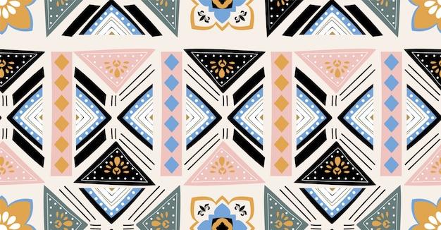 正方形、部族、円形のアフリカスタイルのピンクグリーンブルーブラック幾何学的シームレスパターン