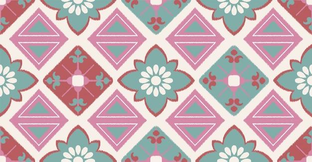 アフリカ風の緑ピンクの幾何学的なシームレスパターン
