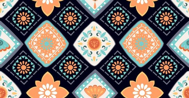 アフリカスタイルのカラフルな幾何学的なシームレスパターン